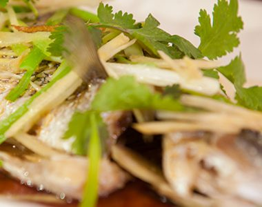 Steamed Baby Barramundi with Ginger and Coriander Soy