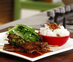 Honey and Soy Sticky Skewers on Asian Greens